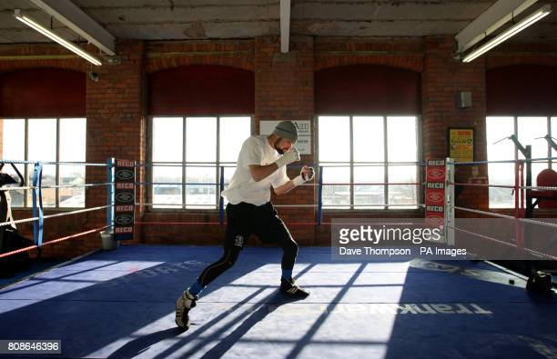 Boxer Tony Bellew shadow boxes during the Media Work Out at Arnies Gym Manchester