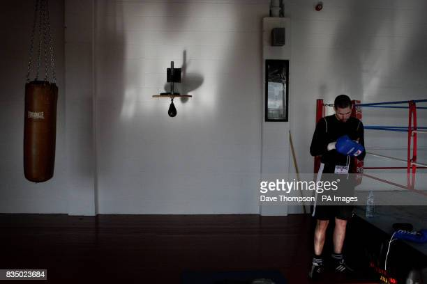 Boxer Tony Bellew stands beside the ring at the former WBU Middleweight Champion Anthony Farnell's Arnies Gym in Manchester