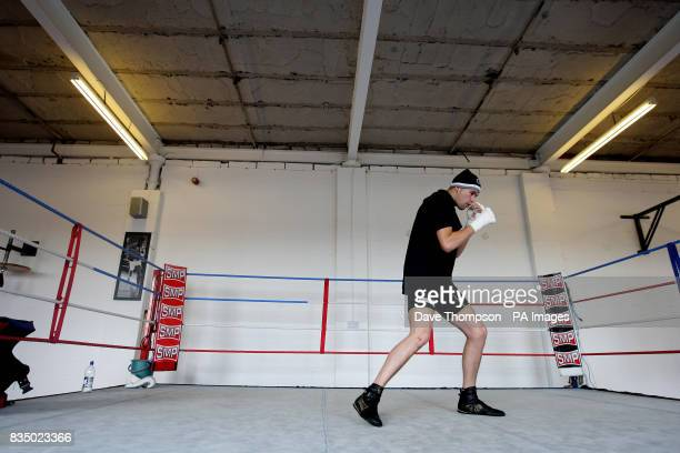 Boxer Tony Bellew trains in the ring of Arnies Gym belonging to former WBU Middleweight Champion Anthony Farnell in Manchester