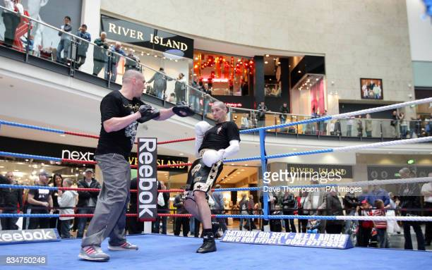 Boxer Tony Bellew trains with coach Anthony Farnell during a special open training session at the Arndale Shopping centre Manchester