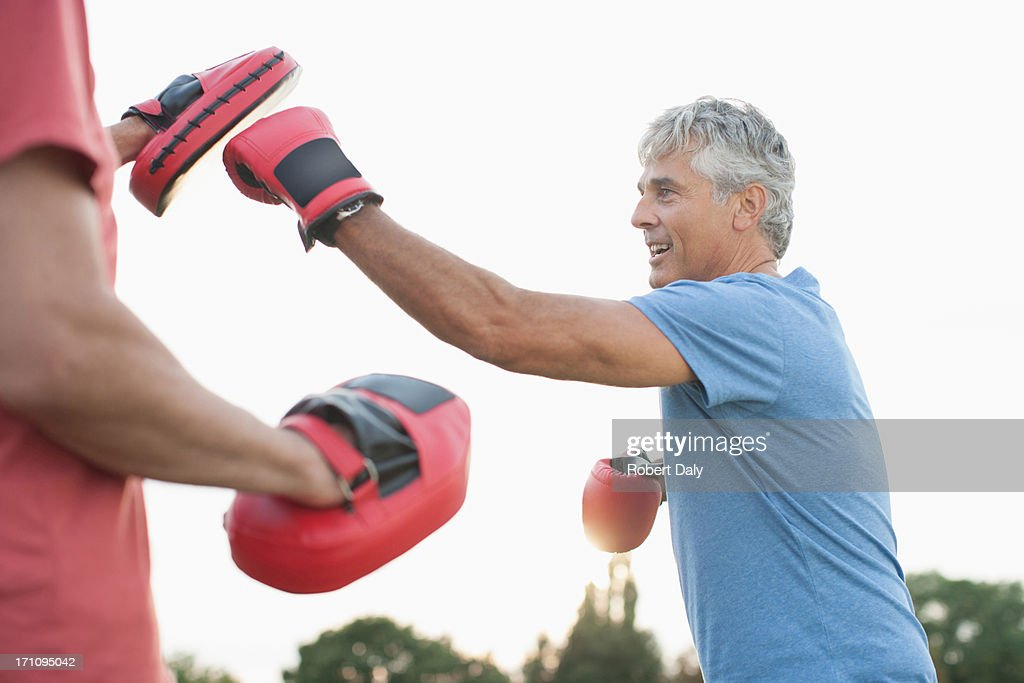 Boxer training with sparring partner