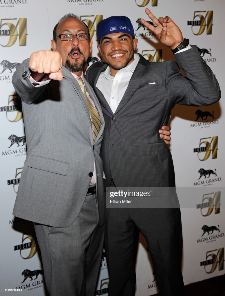 Boxer <a gi-track='captionPersonalityLinkClicked' href=/galleries/search?phrase=Victor+Ortiz&family=editorial&specificpeople=2809263 ng-click='$event.stopPropagation()'>Victor Ortiz</a> (R) and his manager Rolando Arellano arrive at a post-fight party at Studio 54 inside the MGM Grand Hotel/Casino early on September 18, 2011 in Las Vegas, Nevada. Ortiz lost the WBC welterweight title to Floyd Mayweather Jr. by fourth-round knockout on September 17.