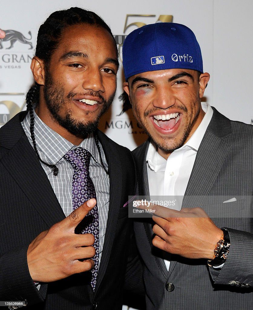 Boxer <a gi-track='captionPersonalityLinkClicked' href=/galleries/search?phrase=Victor+Ortiz&family=editorial&specificpeople=2809263 ng-click='$event.stopPropagation()'>Victor Ortiz</a> (R) and his sparring partner Karl Dargan arrive at a post-fight party at Studio 54 inside the MGM Grand Hotel/Casino early on September 18, 2011 in Las Vegas, Nevada. Ortiz lost the WBC welterweight title to Floyd Mayweather Jr. by fourth-round knockout on September 17.