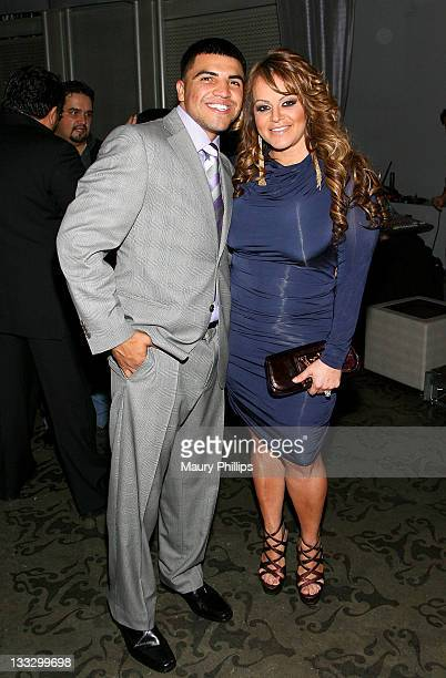 Boxer Victor Ortiz and Jenni Rivera attend the 'Para' Latinos Event at Rolling Stone Restaurant And Lounge on November 17 2011 in Los Angeles...
