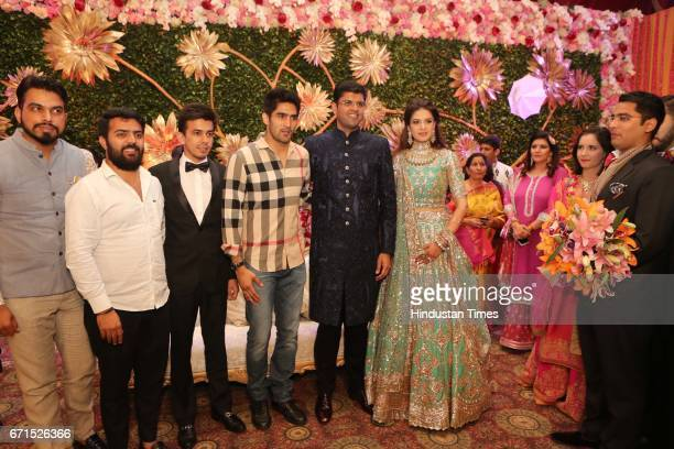 Boxer Vijender Singh with INLD MP Dushyant Chautala and Meghna Ahlawat during their wedding reception at Ashoka Hotel on April 20 2017 in New Delhi...