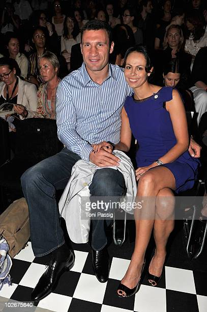 Boxer Vitali Klitschko and wife Natalia Klitschko pose in front row at the Lena Hoschek Show during the Mercedes Benz Fashion Week Spring/Summer 2011...