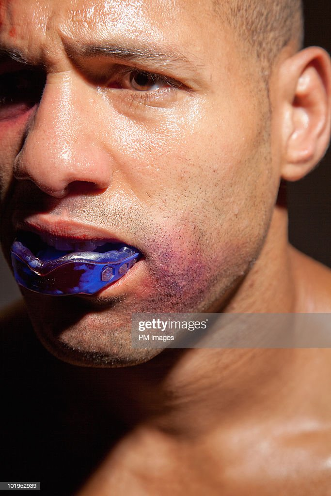 Boxer with bloody mouth guard : Stock Photo