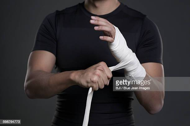 Boxer wrapping hands
