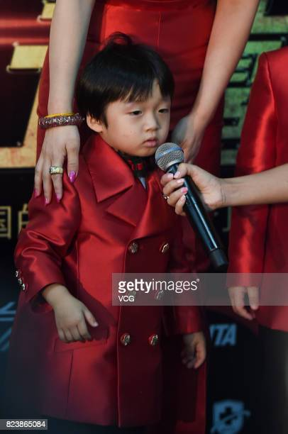 Boxer Zou Shiming's son Zou Minghao arrives at the red carpet of WBO Championship Defending Fight between Zou Shiming and Sho Kimura on July 28 2017...