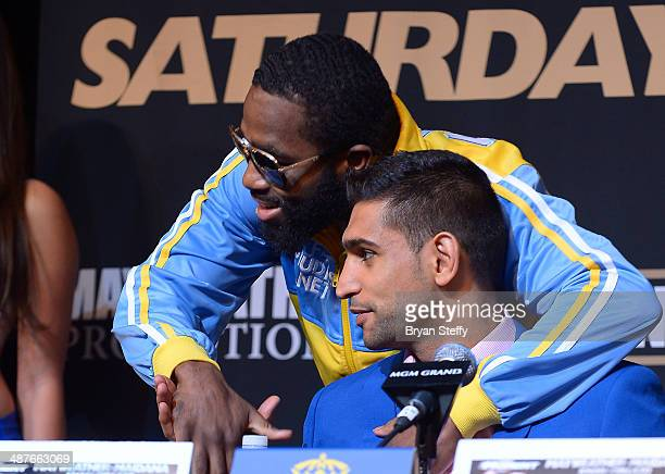 Boxers Adrien Broner and Amir Khan pose for the camera during the undercard final press conference at the MGM Grand Hotel/Casino on May 1 2014 in Las...