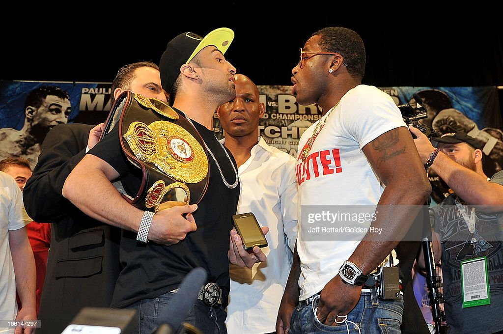 Boxers Adrien Broner (R) and Paulie Malignaggi face off during their news conference before the Floyd Mayweather Jr. and Robert Guerrero fight at the MGM Grand Garden Arena on May 4, 2013 in Las Vegas, Nevada.