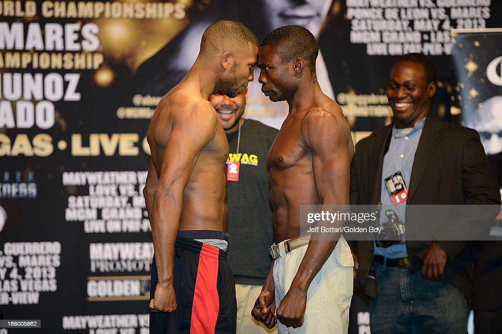 Boxers Badou Jack (L) and Michael Gbenga face off during the official weigh-in for their light heavyweight bout at the MGM Grand Garden Arena on May 3, 2013 in Las Vegas, Nevada.