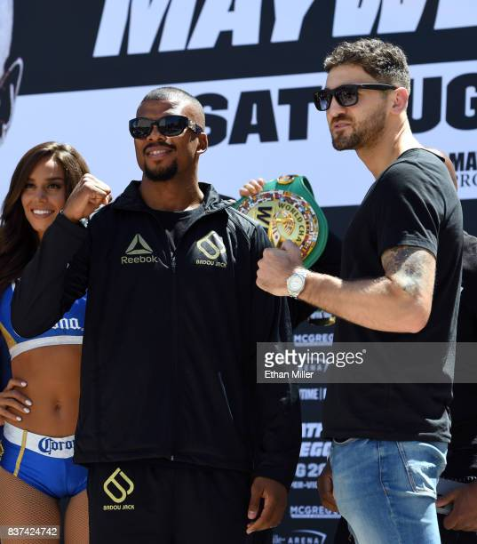 Boxers Badou Jack and WBA light heavyweight champion Nathan Cleverly pose after arriving at Toshiba Plaza on August 22 2017 in Las Vegas Nevada...