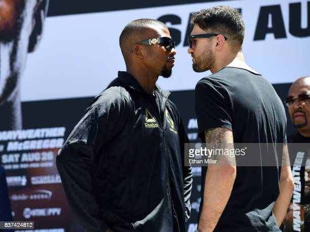 Boxers Badou Jack and WBA light heavyweight champion Nathan Cleverly face off after arriving at Toshiba Plaza on August 22 2017 in Las Vegas Nevada...