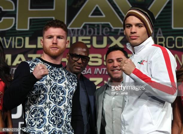 Boxers Canelo Alvarez and Julio Cesar Chavez Jr pose during a news conference as Golden Boy Promotions partner Bernard Hopkins and Golden Boy...