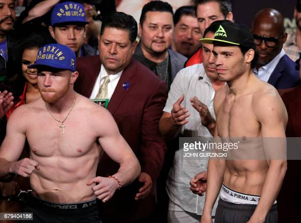 Boxers Canelo Alvarez and Julio Cesar Chavez Jr pose during their weighin Friday May 5 2017 at the MGM Grand Arena in Las Vegas Nevada Mexican...