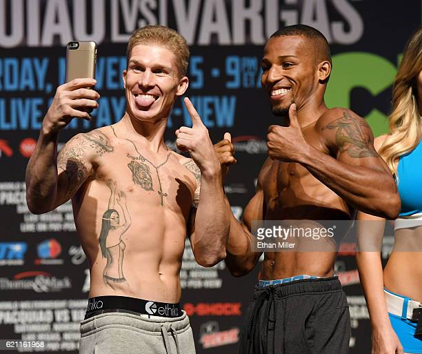 Boxers Clay Burns and Robson Conceicao take a photo together as they pose during their official weighin at the Encore Theater at Wynn Las Vegas on...