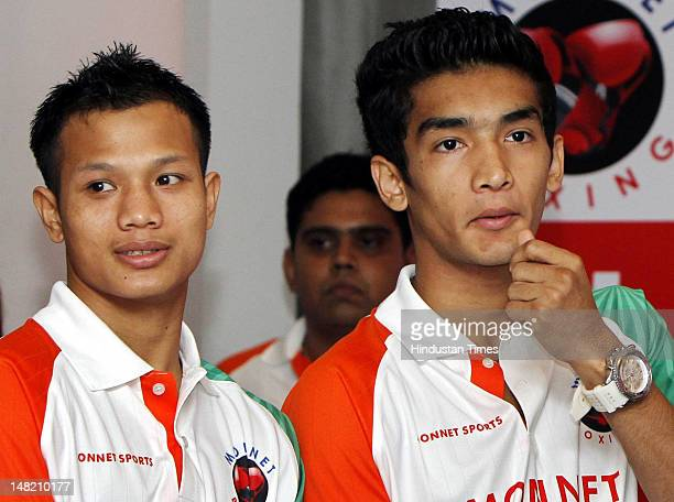 Boxers Devendro Singh and Shiva Thapa attend a press conference on July 12 2012 in New Delhi India