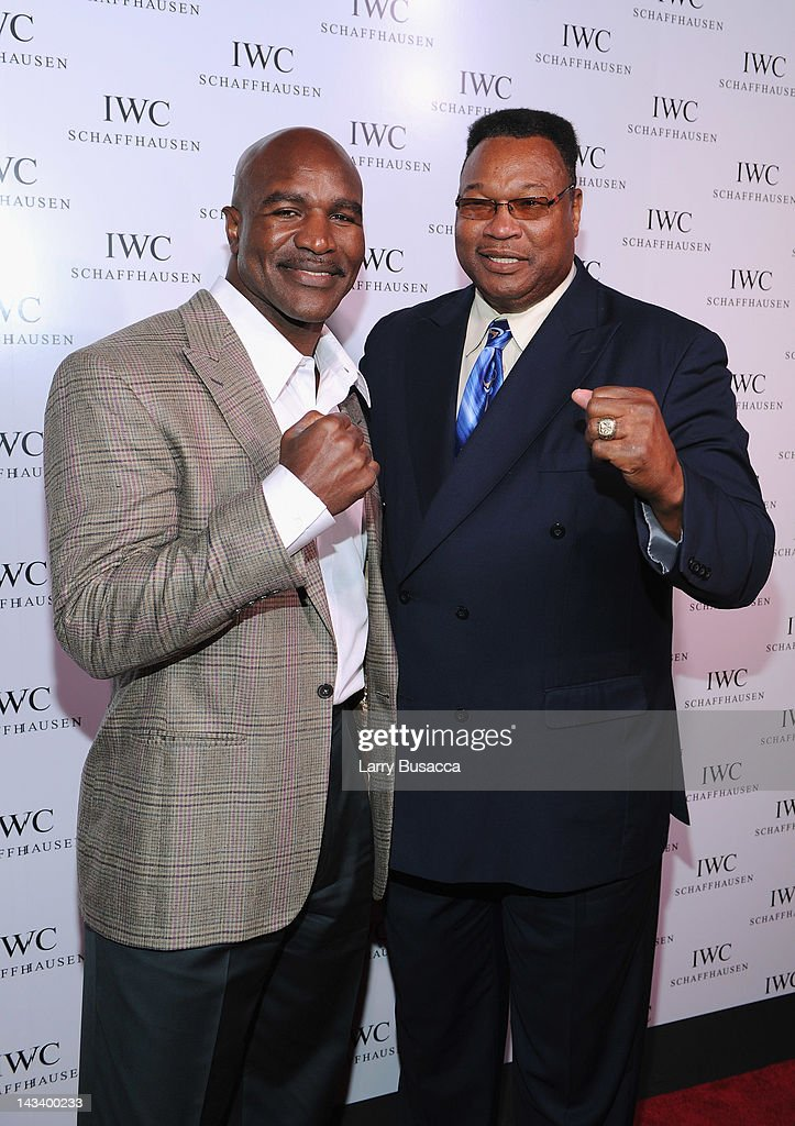 Boxers <a gi-track='captionPersonalityLinkClicked' href=/galleries/search?phrase=Evander+Holyfield&family=editorial&specificpeople=194938 ng-click='$event.stopPropagation()'>Evander Holyfield</a> and <a gi-track='captionPersonalityLinkClicked' href=/galleries/search?phrase=Larry+Holmes&family=editorial&specificpeople=730775 ng-click='$event.stopPropagation()'>Larry Holmes</a> attend IWC Flagship Boutique New York City Grand Opening at IWC Boutique on April 25, 2012 in New York City.