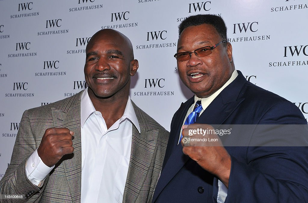 Boxers <a gi-track='captionPersonalityLinkClicked' href=/galleries/search?phrase=Evander+Holyfield&family=editorial&specificpeople=194938 ng-click='$event.stopPropagation()'>Evander Holyfield</a> and <a gi-track='captionPersonalityLinkClicked' href=/galleries/search?phrase=Larry+Holmes&family=editorial&specificpeople=730775 ng-click='$event.stopPropagation()'>Larry Holmes</a> attend the IWC Flagship Boutique New York City Grand Opening at IWC Boutique on April 25, 2012 in New York City.