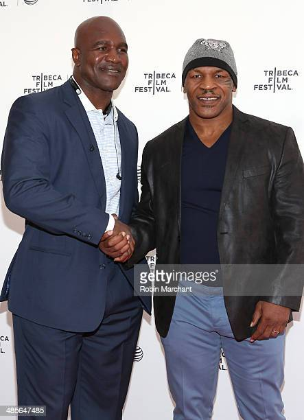 Boxers Evander Holyfield and Mike Tyson attend Tribeca Talks After the Movie 'Champs' during the 2014 Tribeca Film Festival at the SVA Theater on...