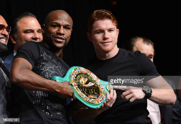 Boxers Floyd Mayweather Jr and Canelo Alvarez hold a WBC super welterweight championship belt during the final news conference for their bout at the...
