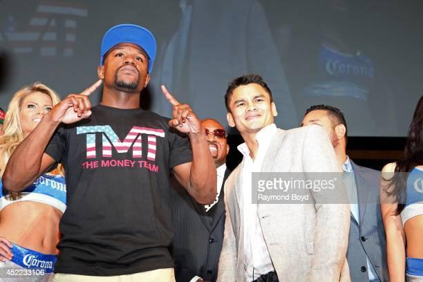 Boxers Floyd 'Money' Mayweather and boxer Marcos 'El Chino' Maidana poses for photos at the end of the 'Mayhem Mayweather vs Maidana II' championship...