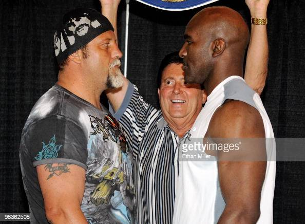 Boxers Francois Botha and Evander Holyfield face off in front of Crown Boxing matchmaker Frank Luca during the official weighin for their bout at the...