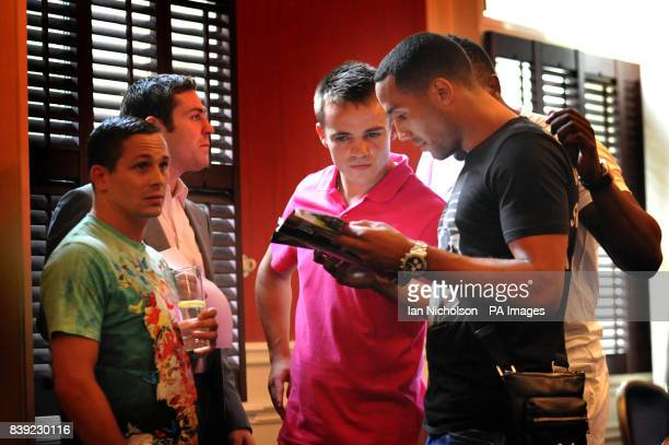 Boxers James DeGale Frankie Gavin Don Broadhurst and Matthew Macklin read a press release before a Frank Warren Promotions announcement at the...