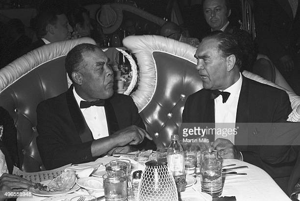 Boxers Joe Louis and Max Schmeling enjoy a dinner together in 1971 in Los Angeles California