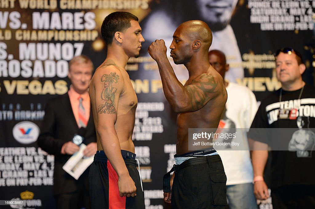 Boxers Luis Arias (L) and Donyil Livingston face off during the official weigh-in for super middleweight bout at the MGM Grand Garden Arena on May 3, 2013 in Las Vegas, Nevada.