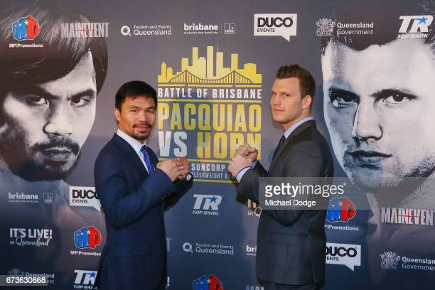 Boxers Manny Pacquiao of the Philippines and Jeff Horn of Australia pose for the media during a press conference at Invictus Gym on April 27 2017 in...