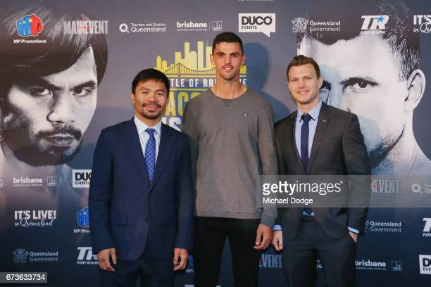 Boxers Manny Pacquiao of the Philippines and Jeff Horn of Australia pose for the media with AFL Player Scott Pendlebury of the Collingwood Magpies...