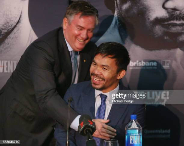 Boxers Manny Pacquiao of the Philippines is hugged by Collingwood Magpies President and host for today Eddie Maguire during a press conference at...