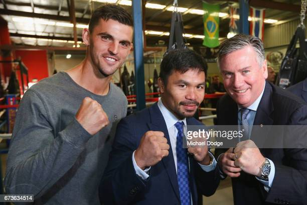 Boxers Manny Pacquiao of the Philippines poses for the media with AFL Player Scott Pendlebury of the Collingwood Magpies and Magpies President and...