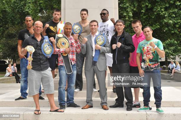 Boxers pose following a London news conference promoting a night of world championship boxing labelled The Magnificent Seven From left James DeGale...