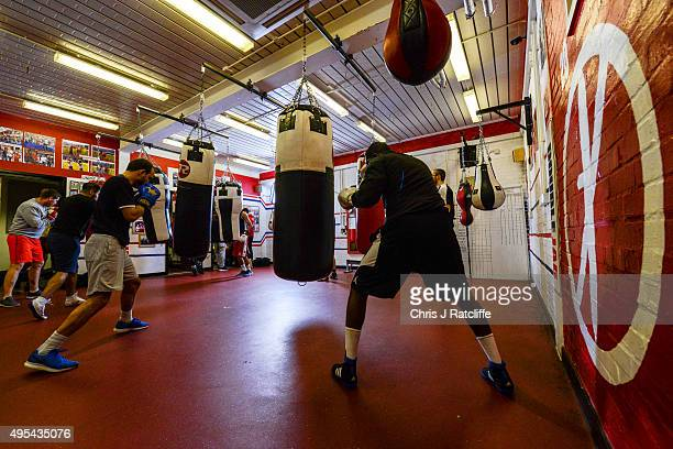 Boxers work the bags in the bag room during a training session at Double Jab Boxing Club in New Cross on November 2 2015 in London England With the...