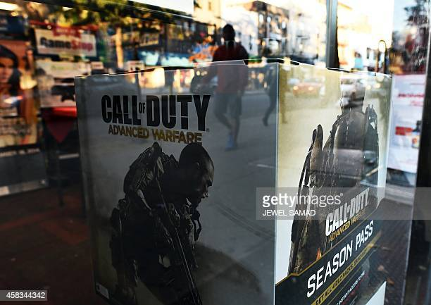 Boxes advertising the newest installment to blockbuster video game 'Call of Duty' is displayed in a gamestop store in New York on November 3 2014 The...