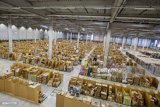 Boxes and parcels sit stacked in bays ahead of shipping from the warehouse of an Amazoncom Inc fulfillment center in Koblenz Germany on Tuesday Nov...