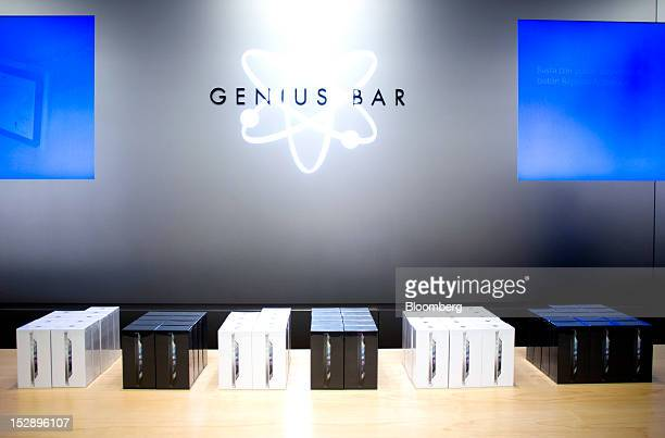 Boxes containing Apple Inc iPhone 5's are seen stacked on the genius bar at the Apple store in the Gran Plaza 2 shopping mall in Majadahonda near...