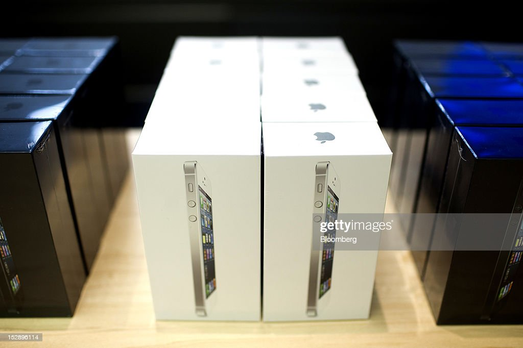 Boxes containing Apple Inc. iPhone 5's are seen stacked on the genius bar at the Apple store in the Gran Plaza 2 shopping mall in Majadahonda, near Madrid, Spain, on Friday, Sept. 28, 2012. Apple said it is working to catch up with demand, 'We are working hard to get an iPhone 5 into the hands of every customer who wants one as quickly as possible,' Apple Chief Executive Officer Tim Cook said in a statement. Photographer: Angel Navarrete/Bloomberg via Getty Images