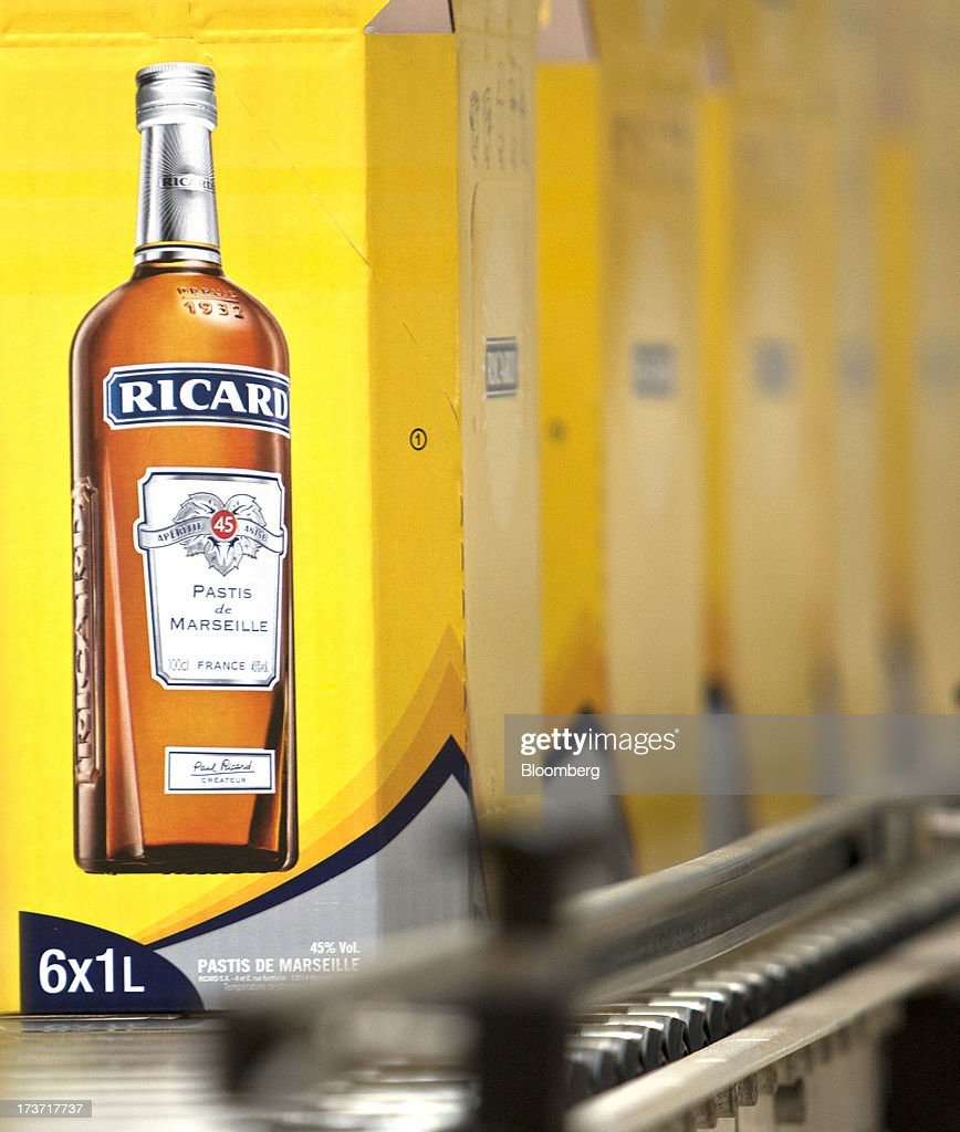 Boxes containing bottles of Ricard pastis, produced by Pernod Ricard SA, travel along an automated production line at the company's plant in Bordeaux, France, on Tuesday, July 16, 2013. Distillers such as Diageo and Pernod Ricard SA are seeking to expand in emerging markets where booming economic growth is creating a burgeoning middle class with more disposable income. Photographer: Balint Porneczi/Bloomberg via Getty Images