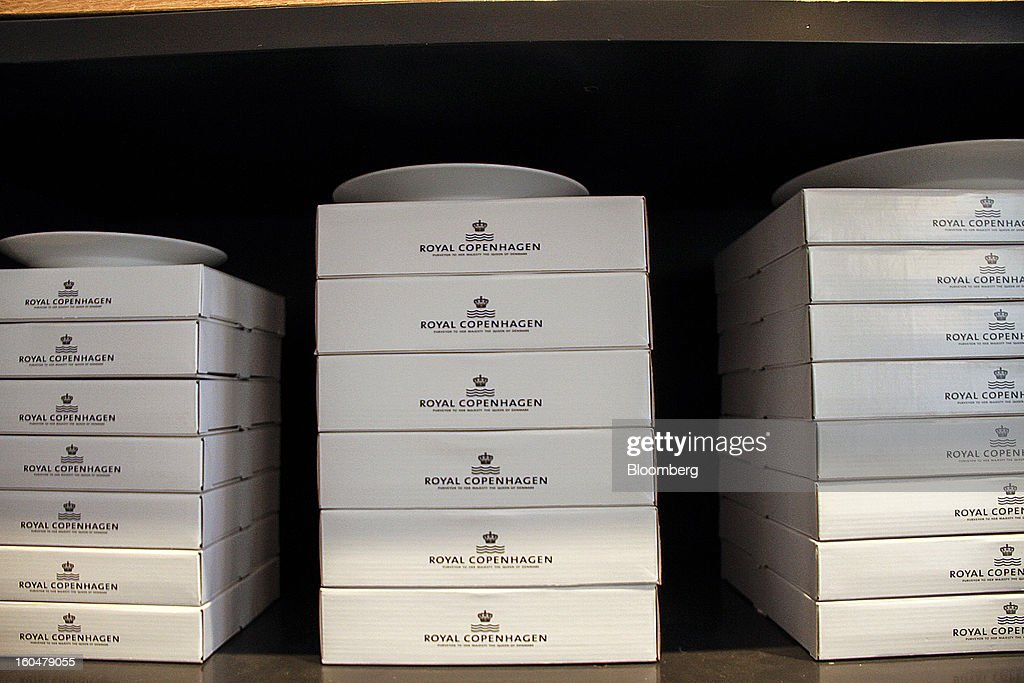 Boxes containing Danish porcelain plates sit on a shelf inside the Royal Copenhagen store on Storget street in Copenhagen, Denmark, on Friday, Feb. 1, 2013. Danish regional banks are struggling to emerge from a burst property bubble that's forced the government resolution agency to take over a dozen lenders after losses on commercial and agricultural loans wiped out capital. Photographer: Freya Ingrid Morales/Bloomberg via Getty Images