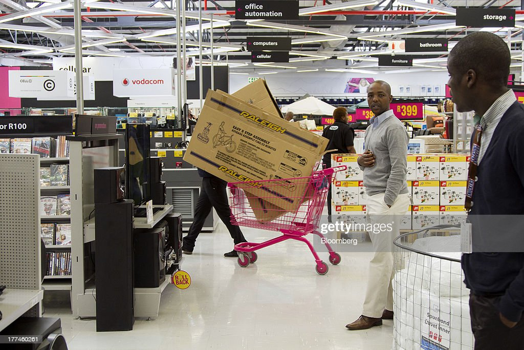 Boxes containing Raleigh bicycles fill a shopping cart inside a Game supermarket, part of Massmart Holdings Ltd., in the Fourways district of Johannesburg, South Africa, on Thursday, Aug. 22, 2013. Massmart Holdings Ltd., the South African food and goods wholesaler owned by Wal-Mart Stores Inc., said revenue growth continued to slow in August after a downturn in consumer spending hurt first-half earnings. Photographer: Nadine Hutton/Bloomberg via Getty Images