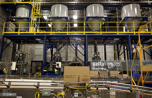 Boxes containing Tim Hortons Inc coffee packets move along a conveyor belt at the company's roasting plant in Ancaster Ontario Canada on Monday Aug...