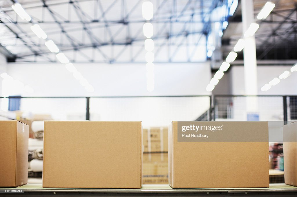 Boxes in row in shipping area : Stock Photo