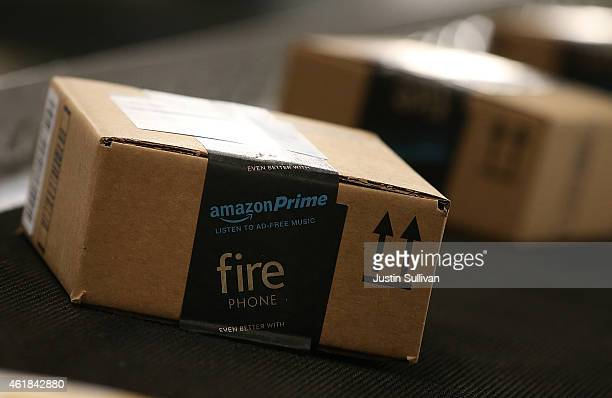 Boxes move along a conveyor belt at an Amazon fulfillment center on January 20 2015 in Tracy California Amazon officially opened its new 12 million...