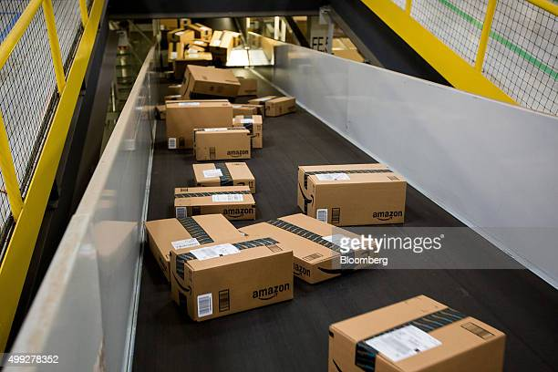 Boxes move along a conveyor belt at the Amazoncom Inc fulfillment center on Cyber Monday in Robbinsville New Jersey US on Monday Nov 30 2015 Online...