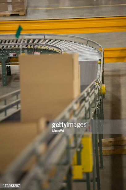 Boxes moving through a conveyer belt inside a warehouse