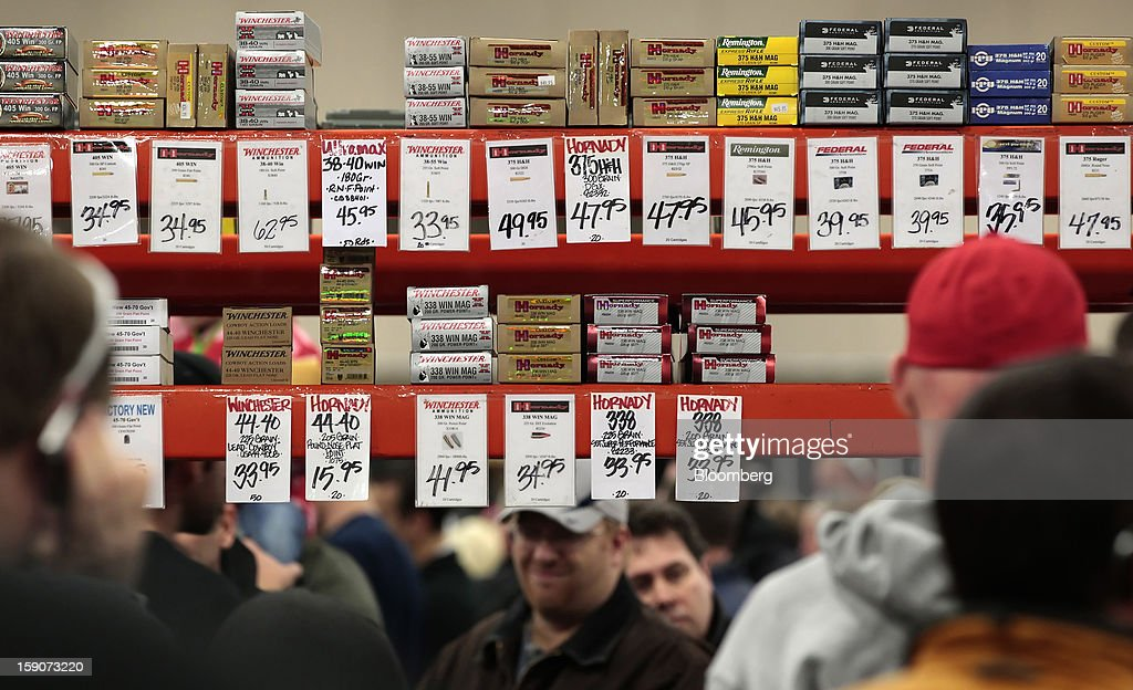 Boxes of ammunition are displayed for sale at the Rocky Mountain Gun Show in Sandy, Utah, U.S., on Saturday, Jan. 5, 2013. A working group led by Vice President Joe Biden is seriously considering measures that would require universal background checks for firearm buyers, track the movement and sale of weapons through a national database, strengthen mental health checks and stiffen penalties for carrying guns near schools or giving them to minors. Photographer: George Frey/Bloomberg via Getty Images